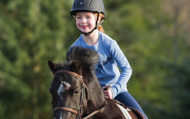 Childrens Riding Wear Girl riding a horse