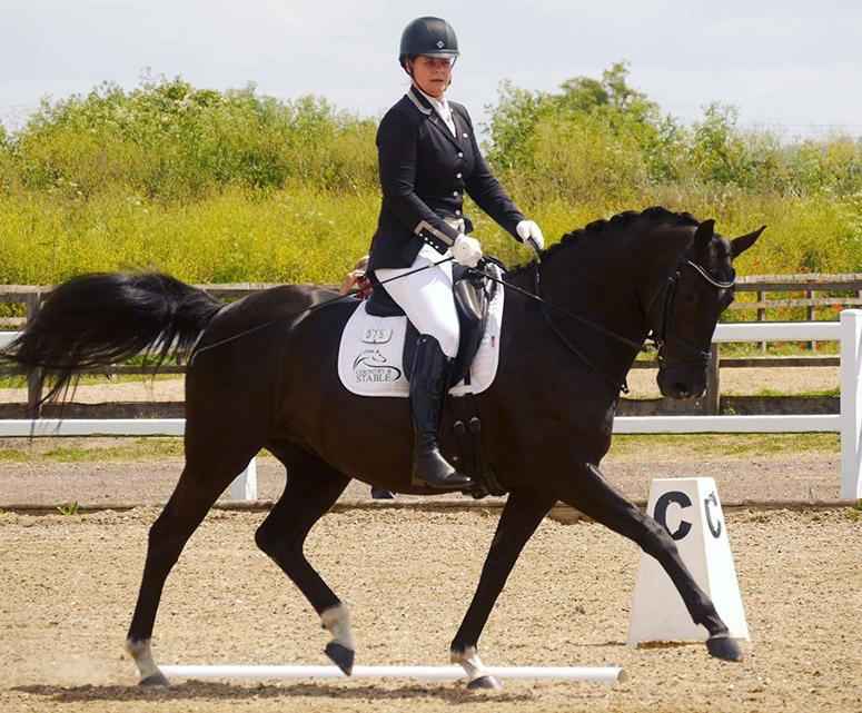 British woman riding a dressage horse